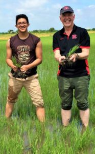 Paul Robson and Justo Calderon in Thailand rice field.